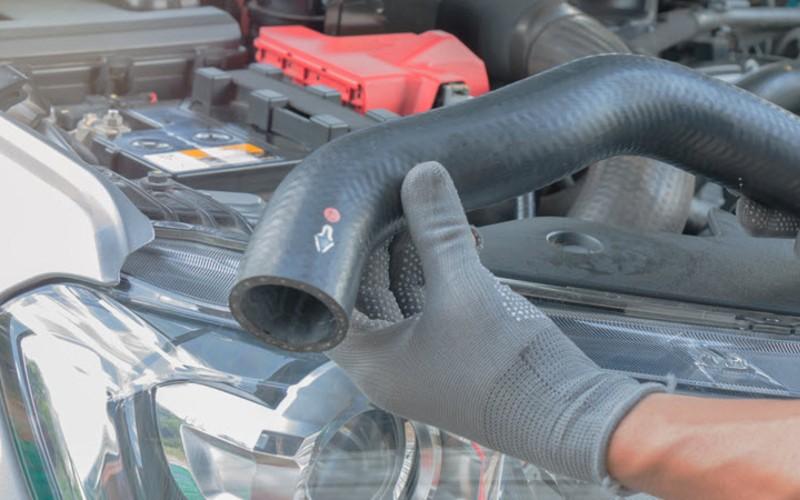Repair of worn hose as a part of belts & hoses repairs for a car in Tustin, CA